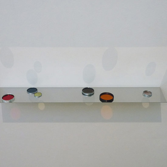 Filterd Light IX, 2014 / fotofilters and lenses, polished stainless steel / 4 x 68 x 11.8 cm