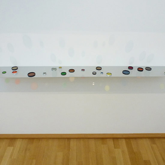 Filterd Light IX, 2014 / fotofilters and lenses, polished stainless steel / 6 x 168.5 x 21 cm